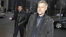 Ned Maodus (L) and Ray Pollard, two of the five former drug squad officers on trial in charges involving alleged falsification of notes, assaults on drug dealers and illegal searches walk on Queen St., after leaving the University Ave., Courthouse in Toronto on Jan. 16, 2012. (Fernando Morales/The Globe and Mail)