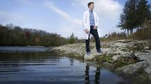 Adam Noble, who will be presenting his research at the Nobel prize ceremonies in Stockholm in December, is seen on the shores of Otonabee River near Trent University in Peterborough, Ont. Friday, Oct. 26, 2012. (Kevin Van Paassen/The Globe and Mail)