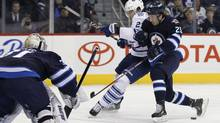 Winnipeg Jets' Zach Redmond could miss the rest of the season after suffering a serious cut during practice on Thursday. In this file photo, Redmond (right) takes Toronto Maple Leafs' James van Riemsdyk off the puck during second period NHL action in Winnipeg on Thursday, February 7, 2013. (JOHN WOODS/THE CANADIAN PRESS)