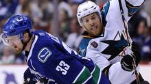 Joe Pavelski of the San Jose Sharks and Henrik Sedin of the Vancouver Canucks collide at centre ice. (Photo by Harry How/Getty Images) (Harry How/Harry How/Getty Images)