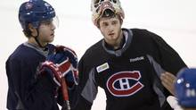 Montreal Canadiens defenceman Nathan Beaulieu (40) and Montreal Canadiens goalie Dustin Tokarski (35) take part in the team's practice Wednesday, May 21, 2014 in Brossard, Que. (Ryan Remiorz/THE CANADIAN PRESS)