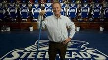 First the Hershey Centre in Mississauga was home to the Ice Dogs, then the St. Mike's Majors, and now it is home to the Mississauga Steelheads. The OHL has had difficulty attracting a fan base in Mississauga, but the team's new President, Elliott Kerr, is attempting to change that with his new team and his marketing expertise. He is photographed in the Steelheads' dressing room on Sept. 17, 2012. (Peter Power/The Globe and Mail)