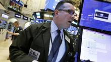 Trader Edward Curran works on the floor of the New York Stock Exchange, Monday, March 20. (Richard Drew/AP)