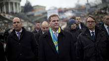 Canada's Minister of Foreign Affairs John Baird, centre, walks in Kiev's Independence Square, during a visit to Ukraine on Feb. 28, 2014. (Emilio Morenatti/AP)