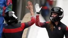 Heather Moyse, right, with pilot Kaillie Humphries at the 2014 Sochi Winter Olympics, turned to bobsleigh amid her stellar rugby career. (Fabrizio Bensch/Reuters)