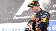 Red Bull driver Sebastian Vettel of Germany sprays champagne as he celebrates his win at the Japanese Formula One Grand Prix at the Suzuka Circuit in Suzuka, Japan, Sunday, Oct. 7, 2012. (Itsuo Inouye/AP)