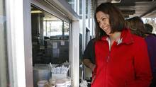 Alberta Wildrose leader Danielle Smith picks up a take out order at Peter's Drive-In while making a campaign stop in Calgary, Alta., Saturday, March 31, 2012. Albertans go to the polls on April 23. (Jeff McIntosh/The Canadian Press/Jeff McIntosh/The Canadian Press)