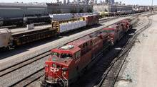 A Canadian Pacific Railway crew works on their train at the CP Rail yards in Calgary. (TODD KOROL/REUTERS)
