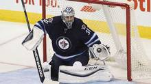 Goalie Ondrej Pavelec returns to the Jets after suffering a knee injury on Nov. 21. (Marianne Helm/Getty Images)