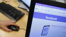 A Facebook page is displayed on a computer screen in Brussels in this April 21, 2010 file photograph. (THIERRY ROGE/REUTERS)