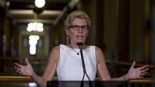 Ontario Premier Kathleen Wynne speaks at Queen's Park in Toronto on Aug. 28, 2013. (PETER POWER/THE GLOBE AND MAIL)
