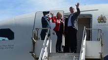 Prime Minister Stephen Harper and wife Laureen depart Calgary on route to Whitehorse on Aug. 18, 2013. (SEAN KILPATRICK/THE CANADIAN PRESS)