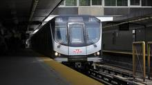 The public finally got to ride the new TTC subway cars , seen here arriving at the Rosedale station's southbound platforms, made by Bombardier on July 21 2011. (Fred Lum/Fred Lum/The Globe and Mail)