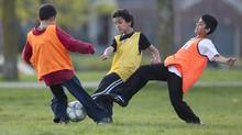 Children take part in a soccer practice on a public field in Toronto on Wednesday, April 25, 2012. (Chris Young For The Globe and Mail)