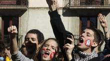 Students shout slogans during a protest against public education spending cuts in Barcelona on Feb. 6, 2013. European Union leaders are expected to set aside more than €5-billion from the EU budget to tackle the bloc's soaring and costly youth unemployment when they meet for a summit in Brussels on Thursday. (ALBERT GEA/REUTERS)