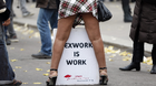 A sex worker activist attends a demonstration with prostitutes against a proposal to scrap sanctions on soliciting and instead punish prostitutes' customers with fines, in Paris November 29, 2013. French lawmakers will start debating today a bill aimed at stemming prostitution with steep fines to clients - a radical switch from the country's traditionally tolerant stance that will give it some of the toughest legislation in Europe. Prostitution is not illegal in France, which has an estimated 18,000 to 20,000 sex workers according to a 2012 report by the Scelles Foundation, but there are laws against pimping, human trafficking and soliciting sex in public.