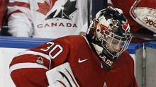 Canada's goaltender Mark Visentin kneels near the bench after the were defeated by Russia in the gold medal game at the IIHF World Junior Hockey Championships in Buffalo, New York, January 5, 2011. (MIKE CASSESE/REUTERS)