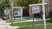 Three homes display 'For Sale' signs in a row on Palma Bonita Lane in Perris, California, in this file photo. (MARK AVERY/REUTERS)