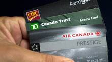 Aimia Inc. is poised to enter a new era in 2014 with TD Bank as its new partner and long-standing ally CIBC both offering credit cards linked to Aimia's Aeroplan rewards. (Ryan Remiorz/The Canadian Press)
