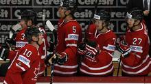 Canada's Corey Perry (L) is congratulated by his teammates after scoring during their 2012 IIHF men's ice hockey World Championship game with Kazakhstan in Helsinki May 12, 2012. (Grigory Dukor/Reuters/Grigory Dukor/Reuters)