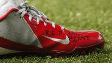 "The shoe of New York Giants wide receiver Victor Cruz bears the words ""R.I.P. Jack Pinto"" in memory of one of the children killed in the Sandy Hook Elementary School shootings in Newtown, Connecticut, during first half NFL play against the Atlanta Falcons, in Atlanta, Georgia, December 16, 2012. (TAMI CHAPPELL/REUTERS)"