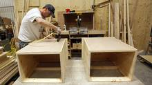 An employee assembles a cabinet at Vokes Furniture in Shallow Lake, Ont. (Deborah Baic/The Globe and Mail)