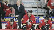 Mike Keenan (L) yells at a referee in the third period of an NHL game in Calgary, Alberta, March 29, 2008 (PATRICK PRICE/REUTERS)