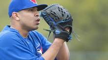 Toronto Blue Jays starting pitcher Ricky Romero pitches during baseball spring training in Dunedin, Fla., on Wednesday, Feb. 20, 2013. (Nathan Denette/THE CANADIAN PRESS)