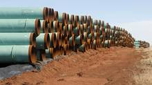Pipes for construction of the Keystone Pipeline are stacked in a field near Ripley, Okla. (Sue Ogrocki/ASSOCIATED PRESS)