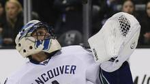 Vancouver Canucks goaltender Roberto Luongo makes a save against the Los Angeles Kings during the second period of their NHL game in Los Angeles, California, January 28, 2013. (LUCY NICHOLSON/REUTERS)