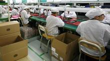 Foxconn, Apple's main global contract manufacturer run by Taiwanese tycoon Terry Gou and employing 1.2 million workers in China, has come under fire in recent years for running massive 'sweatshops' to mass produce high-end iPads and iPhones. (BOBBY YIP/REUTERS/BOBBY YIP/REUTERS)