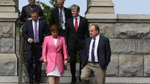 Premier Christy Clark and Green Party MLA Andrew Weaver, leave the legislature to speak to media during an April 2016 press conference. (CHAD HIPOLITO For The Globe and Mail)