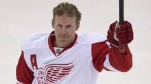 Former Ottawa Senators captain, Detroit Red Wings right wing Daniel Alfredsson acknowldges the crowd prior to the start of NHL action Sunday December 1, 2013 in Ottawa. The game was Alfredsson's first in Ottawa since being traded to the Red Wings. (ADRIAN WYLD/THE CANADIAN PRESS)