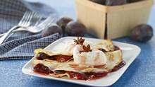 Plum crepes are shown. Blue and Italian plums maintain their shape better than yellow or red plums when cooked. (Michael Mahovlich/THE CANADIAN PRESS)