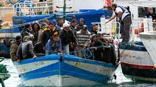 Would-be immigrants arrive in Lampedusa, an Italian island in the Mediterranean, in March. (ALBERTO PIZZOLI/AFP/Getty Images)