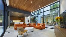 The family room of the home overlooking Toronto's Cedarvale Ravine. A courtyard separates the this area from the main wing of the house.<252> (Tom Arban/Tom Arban Photography)