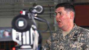 Lt. Col. Jon Jackson, Pentagon-appointed defence lawyer for Omar Khadr, speaks to reporters at Guantanamo Bay, Cuba, on Aug. 8, 2010.