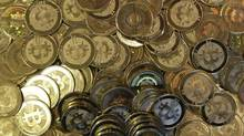 """A tiny Regina bitcoin startup, Dominion Bitcoin Mining Co., says it has been """"exonerated"""" after facing allegations from Saskatchewan's securities regulator last year that it was soliciting investors without the proper paperwork. (RICK BOWMER/The Associated Press)"""