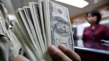U.S. dollar notes (JEWEL SAMAD/Jewel Samada/AFP/Getty Images)