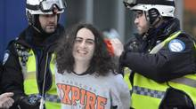 A protester is arrested during an anti-police brutality demonstration in Montreal on March 15, 2013. Police used horses, pepper-spray and kettling tactics to clamp down Friday on an annual protest that has a history of getting rowdy. (Ryan Remiorz/The Canadian Press)