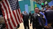 Traders work on the floor of the New York Stock Exchange, September 12, 2012. (BRENDAN MCDERMID/REUTERS)