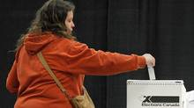 A Charlottetown voter caster her ballot in the federal election on May 2, 2011. (NATHAN ROCHFORD/THE CANADIAN PRESS)