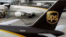 A United Parcel Service Inc. aircraft is loaded with air containers. (JOHN SOMMERS II/JOHN SOMMERS II/REUTERS)