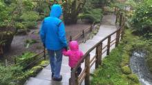 A two-year-old Metis girl at the heart of a court fight between her foster parents and the B.C. government walks with her foster father in Butchart Gardens in Victoria, B.C. in January, 2016. (THE CANADIAN PRESS)