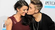 Justin Bieber, right, kisses his mother Pattie Mallette as they arrive at the 40th Anniversary American Music Awards on Sunday, Nov. 18, 2012, in Los Angeles. (Jordan Strauss/Jordan Strauss/Invision/AP)