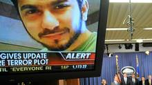 An image of terror suspect Faisal Shahzad is seen on a tv screen as US Attorney General Eric Holder, Secretary of the Department of Homeland Security Janet Napolitano, Deputy Director of the FBI John S. Pistole and New York Police Commissioner Raymond Kelly hold a briefing regarding the investigation into the Times Square attempted bombing, in Washington, DC, on May 4, 2010. (JEWEL SAMAD/JEWEL SAMAD/AFP/Getty Images)