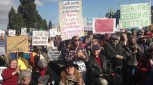 Angry residents from ferry-dependent communities along B.C.'s coast rally at the legislature in Victoria, Tuesday, Match 11, 2014 to protest the impending route reductions. (Dirk Meissner/THE CANADIAN PRESS)