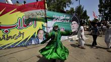 Supporters of anti-government cleric Tahir-ul-Qadri dance during a protest, in Islamabad on Aug. 17. (Anjum Naveed/AP)
