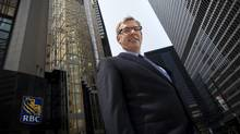 Dave McKay, CEO of RBC, poses on Bay Street in Toronto on Friday, July 25, 2014. (Darren Calabrese For The Globe and Mail)