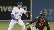 Baltimore Orioles' Adam Jones slides safely into second with a double as Toronto Blue Jays' Troy Tulowitzki waits for the throw in from right field in the fifth inning of their AL baseball game in Toronto on Friday April 14, 2017. (Fred Thornhill/THE CANADIAN PRESS)